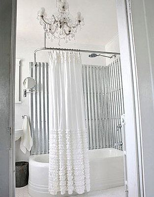 Shabby chic bathroom with galvanized steel and ruffled anthropologie shower curtain.