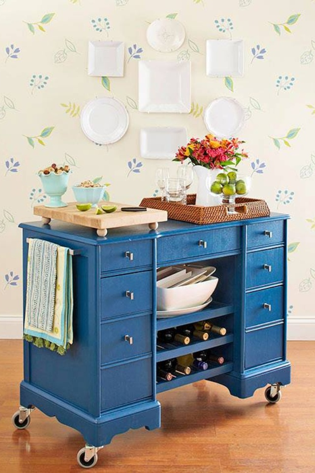 Add casters and a few shelves to an old desk and you've got a great island! Wonderful for the kitchen or the craft room. Or for a cool teacher's classroom.