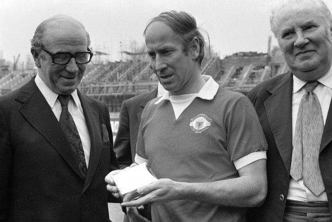 April 28th. 1973. Manchester United give Bobby Charlton a cigarette case before his 604th. and final game at Stamford Bridge against Chelsea. With him are manager Matt Busby and chairman Louis Edwards.