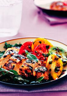 Recipe for Basil Chicken with Grilled Kale and Heirloom Tomatoes, as seen in the October 2004 issue of O, The Oprah Magazine.