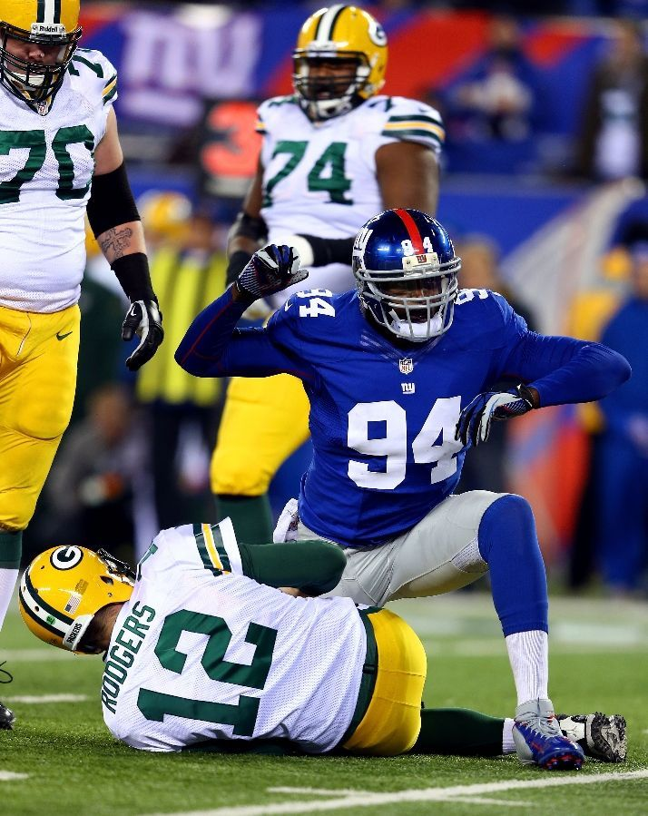 NY Giants Mathias Kiwanuka celebrates a big sack of Packers quarterback Aaron Rodgers. wtg Kiwi!,,