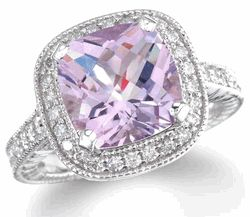 Pink amethyst ring with diamonds! This pink amethyst is a little on the purple side, but definitely not your traditional amethyst. It's also called a Rose Amethyst ring. This ring is made with white gold and diamonds that accent the pink amethyst stone.