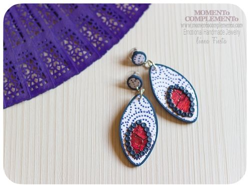 http://momentocomplementodesigns.tictail.com/product/flamenco-earrings-personalized-with-cat-eye-shape-handmade-with-polymer-clay-custom-item
