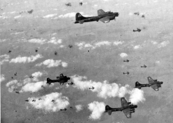 B-17 bombers of the US Eighth Air Force encounter heavy flak over the target area during a mission to Germany.