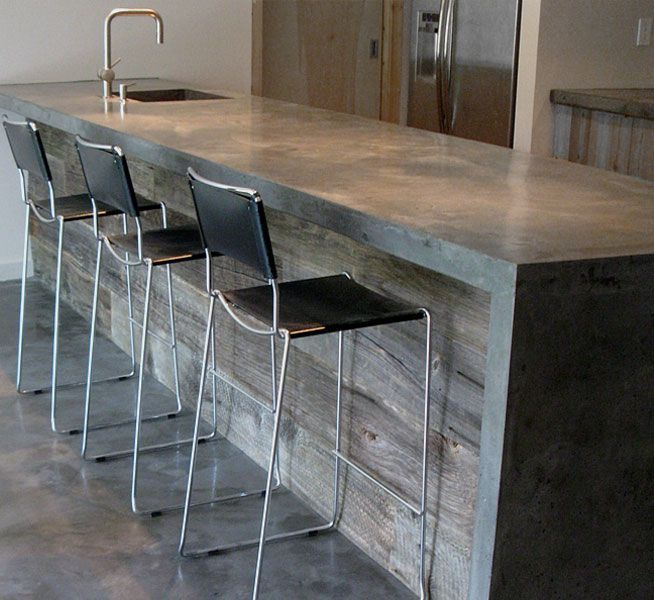 Poured Concrete Kitchen Floor | Poured-in-place concrete island with reclaimed lumber
