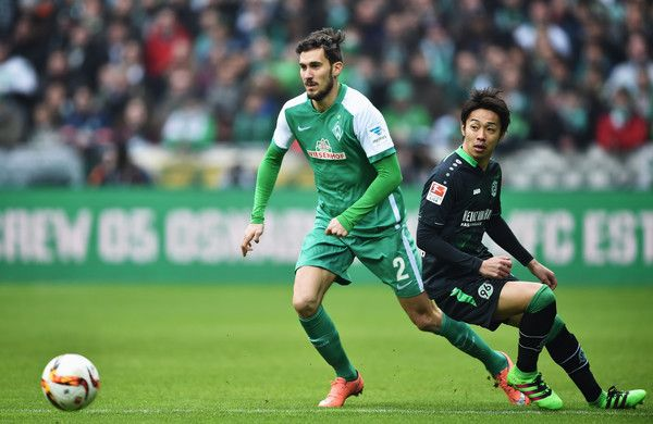 Hiroshi Kiyotake Photos - Santiago García of Bremen is challenged by Hiroshi Kiyotake of Hannover during the Bundesliga match between Werder Bremen and Hannover 96 at Weserstadion on March 5, 2016 in Bremen, Germany. - Werder Bremen v Hannover 96 - Bundesliga
