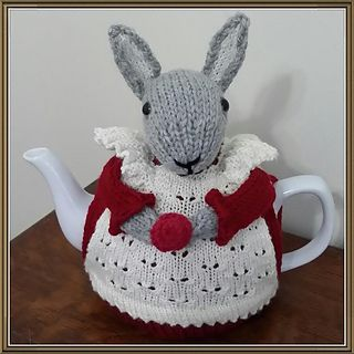 Mrs. Bunny Rabbit, dressed in red, is ready to keep your Christmas teapot warm, whilst adding a whimsical decorating touch to your kitchen or dining room. The tea cozy will fit a medium teapot and is somewhat flexible in fit. This pattern is based on my 2014 design, which was turned into a pattern by popular request.