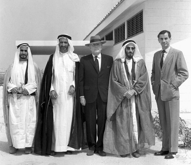 Sheikh Rashid Bin Saeed Ruler of Dubai with UK Political Agents in 1962. The Trucial States were a group of sheikhdoms in the Persian Gulf. They were a British protectorate from 1820 until 1971, when they became the United Arab Emirates. #dubai