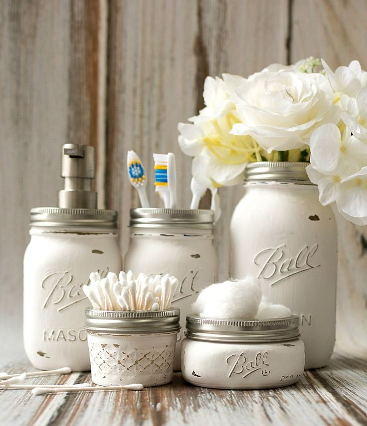 A DIY tutorial on how to make your own mason jar bathroom storage, accessory set.Includes how to paint and distress as well as sources for soap container lid.