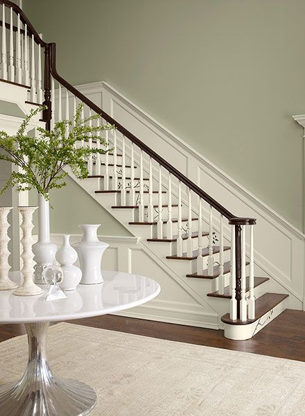 A timeless shade of gray-green accents this traditional staircase. Benjamin Moore October Mist walls, trim Swiss Coffee, accent Hasbrouck Brown