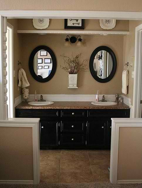 Idea: On half wall, replace counter material with molding to match top of mirror.