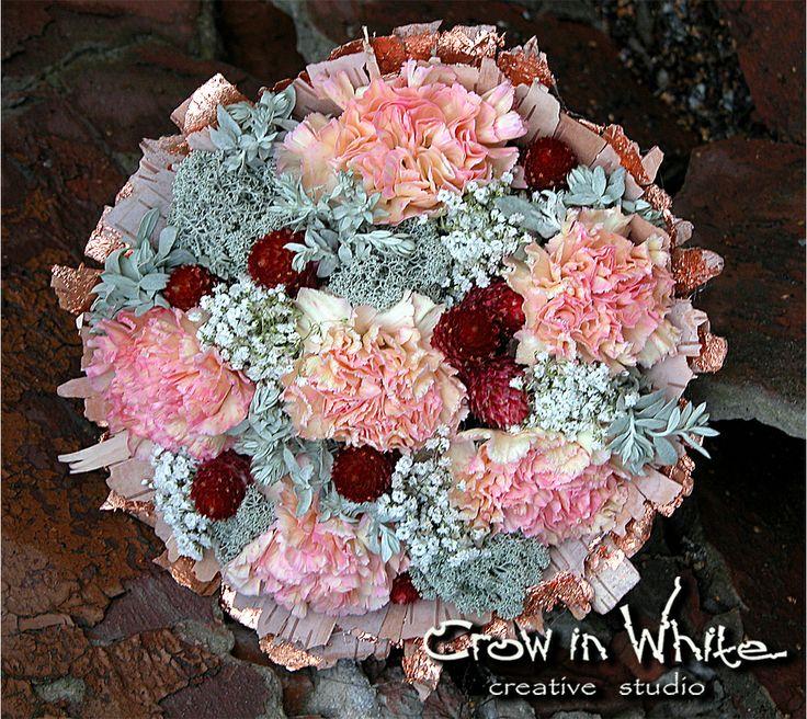 Wedding bouquet in tree bark. Carnation, gypsophila and moss