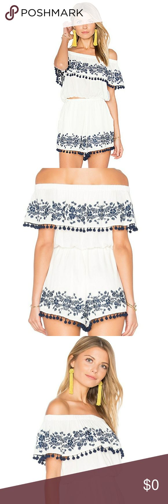 Show Me Your Mumu Teagan Pom Pom Crop Top 🎀Arriving  SOON!!🎀            ⭐🌟SOLD OUT ONLINE ⭐⭐ Off the shoulder crop top  featuring contrast navy embroidery , pom pom trim and elastic neck line and hem . Draped bodice overlay Claims  of running small, suggest sizing up 🌼 Likes will be tagged when it arrives 🌼 Show Me Your MuMu Tops Crop Tops