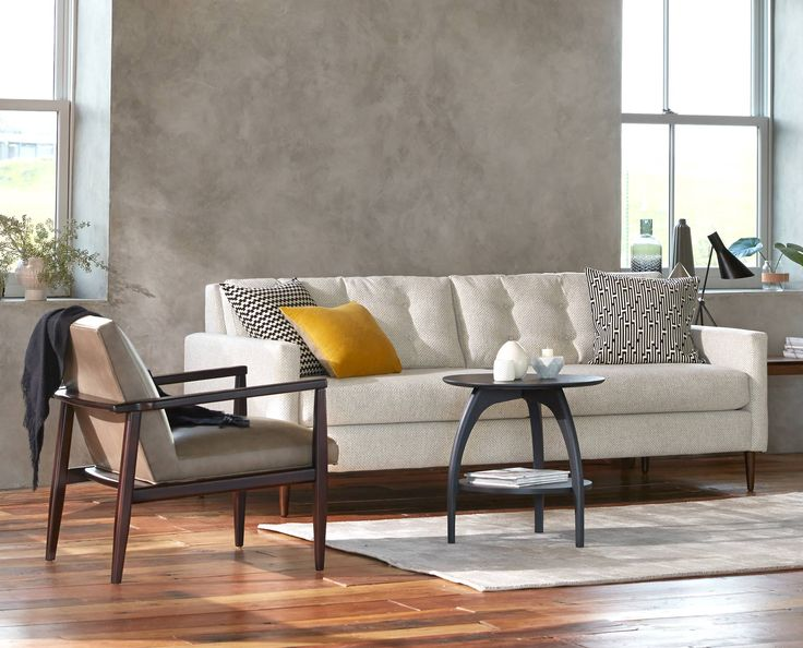 Dania   The Perfectly Proportioned Paramount Sofa Features Loose Cushions  With Classic Button Tufted Backs And Is Supported By Extended Tapered Wood  Legs.