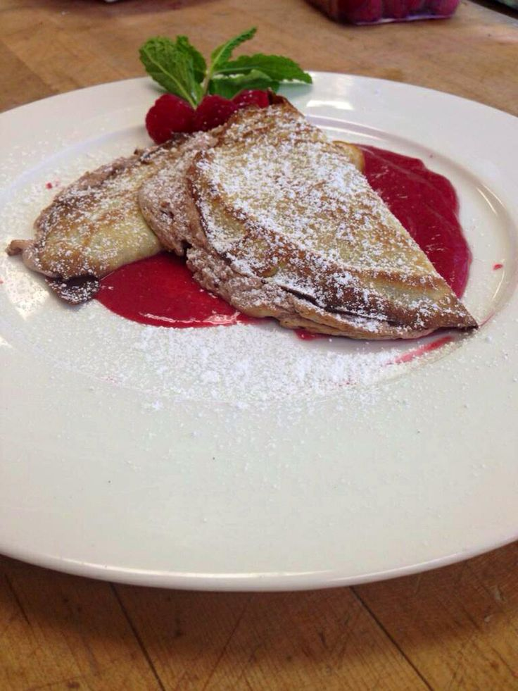 Crepe soufflé with raspberry coulis and dusted with powder sugar!