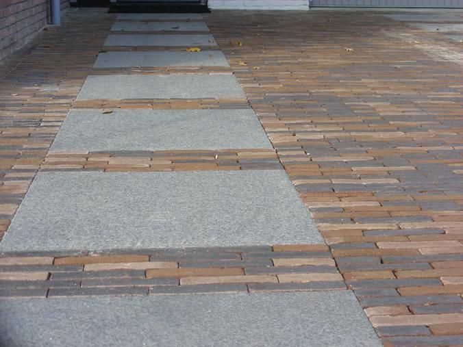 Large cement pavers mixed in with small pavers or bricks