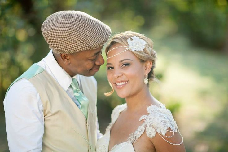 Christill's lace flowers on her Dimity gown were used in her custom hairpiece featuring pearl strands and lace motifs.