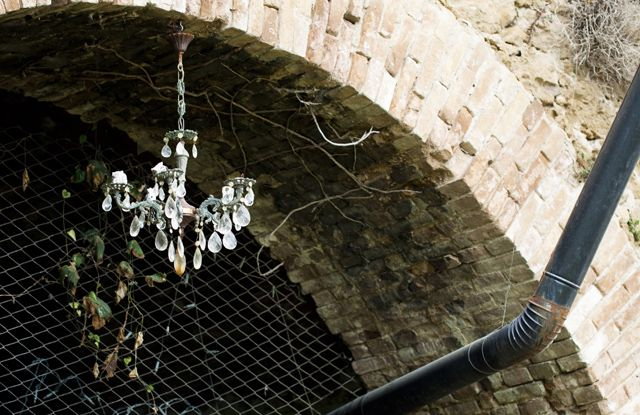 Well, this is possible and real. Took in #bussanavecchia #italy #liguria. #chandelier hanging outside from a bow made of #bricks.