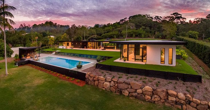 This contemporary Australian home has been designed for indoor/outdoor living and features a minimalist kitchen, outdoor lounge, a swimming pool with cabana and a landscaped yard