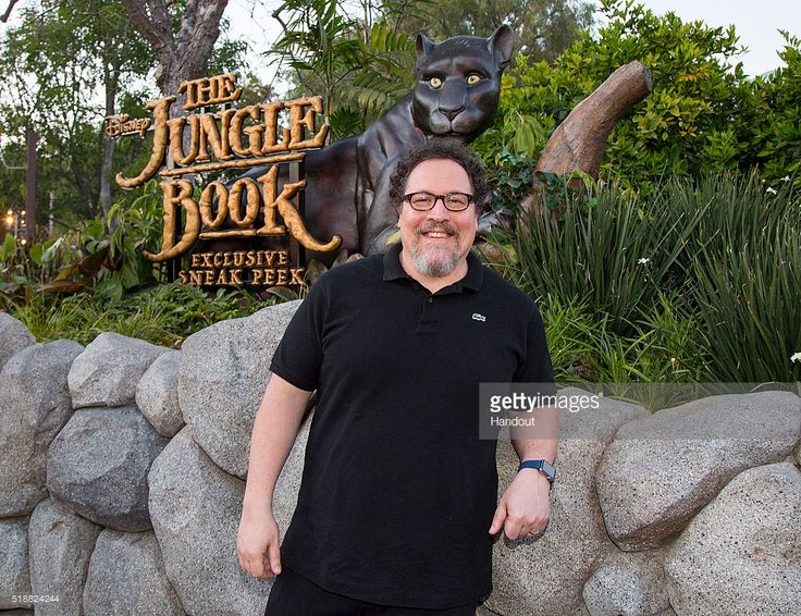 In this handout photo provided by Disneyland Resort, Jon Favreau, director of Disney's 'The Jungle Book', poses in front of the entrance to the film's sneak peek experience at Disney California Adventure Park on Saturday, April 2, 2016 in Anaheim, California. Disney's 'The Jungle Book' opens in theaters April 15, 2016.