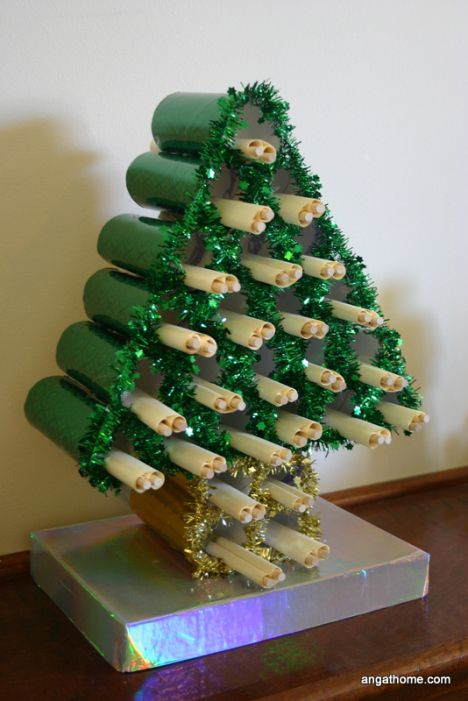 25 hole toilet roll Christmas tree for advent count-down. We store bible reading scrolls to go with our Christian Jesse tree throughout December. Each verse has a symbol to match.