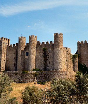 Sleep like a queen in a historic, international castle that has been converted into a hotel in Obidos, Portugal, the walled town that surrounds the Pousada do Castelo, little has changed since the 15th century