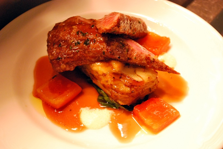 Roasted lamb loin, potato parmesan gratin, wilted baby spinach, confit tomato and red wine jus