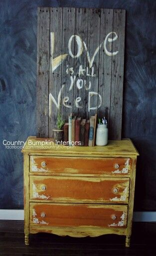 This dresser was done in cece caldwell chalk paint and the sign is made from a pallet :) #upcycled #dresser #bedroom #antique #revamp #handpainted #vintage #decor #interiordecor #DIY #countrybumpkin #dresser #sign #pallet #palletwood #books #masonjar #repurpose #boho #bohemian #rustic