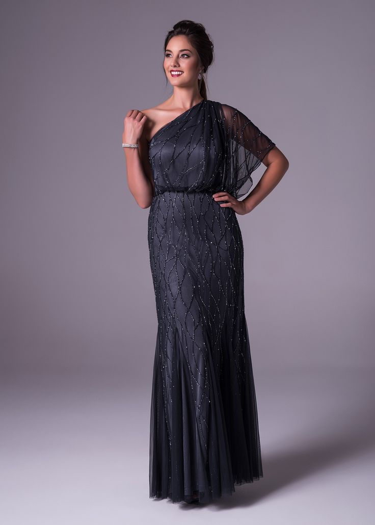 Oleg Cassini chooses navy to show off this classic soft & slim one shoulder gown. Made from soft tulle and fully beaded you are sure to look timeless. Available exclusively from Bride&co: http://www.brideandco.co.za/product/new-collection/wgin0009/