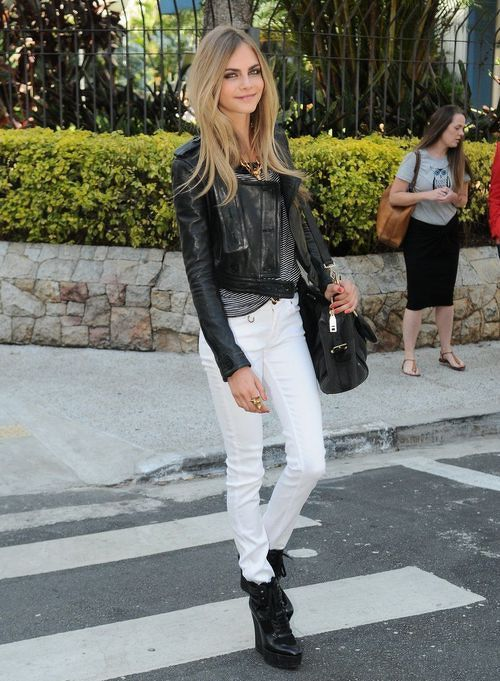 Cara Delevingne  leather jacket + shirt + white jeans + boots