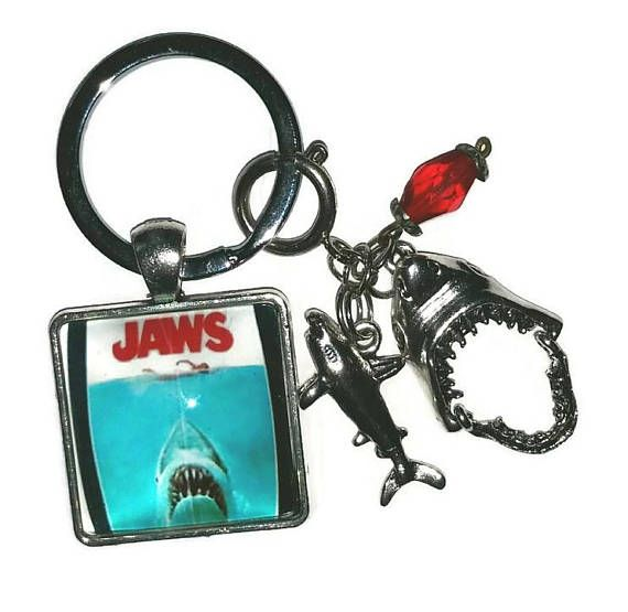 Check out this item in my Etsy shop https://www.etsy.com/ca/listing/545863565/jaws-theme-key-chain-with-shark-charms