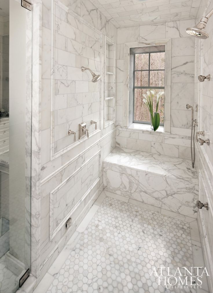 Stainback-Hess Studio - Master bathroom shower features calcutta gold marble  tiles on walls and ceiling accented with calcutta gold marble trim moldings.