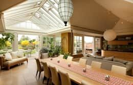 Let your conservatory become a part of your interiors with a open-plan layout! The result is a big room flooded with natural light. That modern conservatory is designed by Westbury Garden Rooms