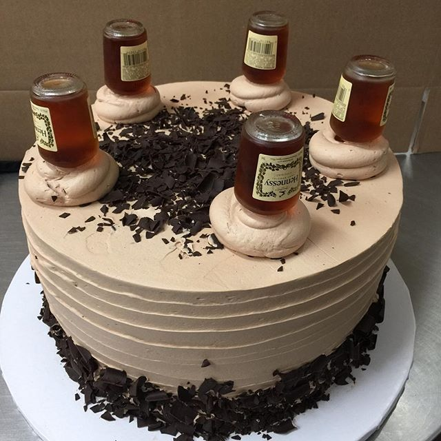 Hennessy cheesecake! Check out the bottles of Hennessy outlining the ...