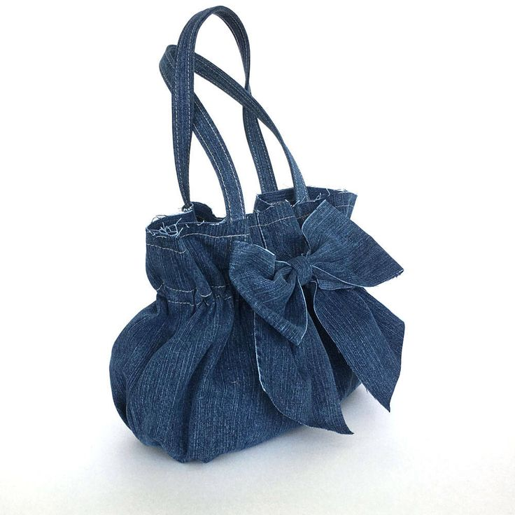 Recycled bow bag , jean purse , recycled denim bow bag , blue handbag , Vegan bag , Top handle bag , Upcycled clothing , girls fashion bag by Sisoibags on Etsy https://www.etsy.com/listing/507634726/recycled-bow-bag-jean-purse-recycled