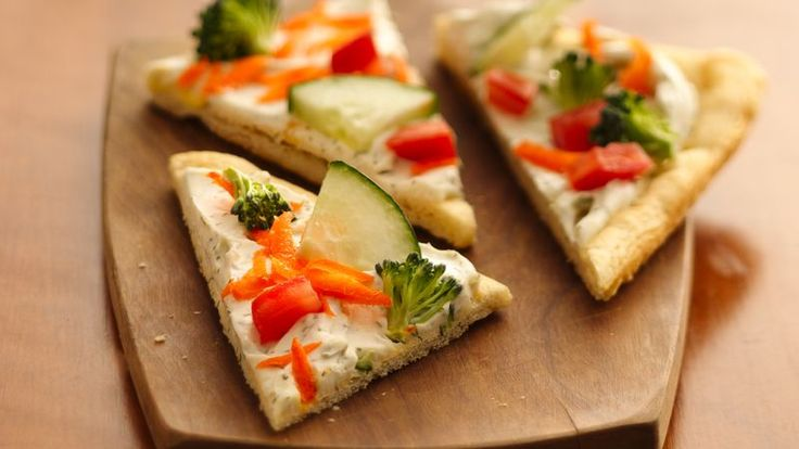 Give cold pizza fans a refreshing change with crunchy fresh veggies atop a creamy dill sauced crust.