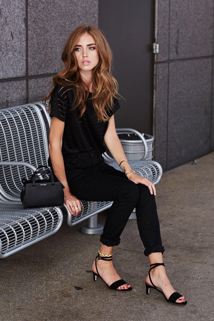 "Girl about town. Chiara Ferragni keeps it classic in an all black ensemble, featuring Calvin Klein Jeans + the ""Sofie"" crossbody duffle."