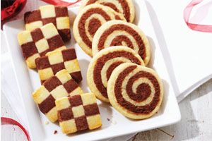 Spiral Cookies- Your kids will love to layer, roll, and of course, eat these sweet little cookies. They combine yummy chocolate and vanilla flavours into one great-looking goodie.