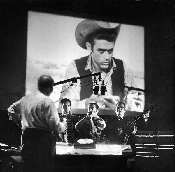 Composer Dimitri Tiomkin (L) directing the muscial score for the last James Dean movie produced 'Giant'.