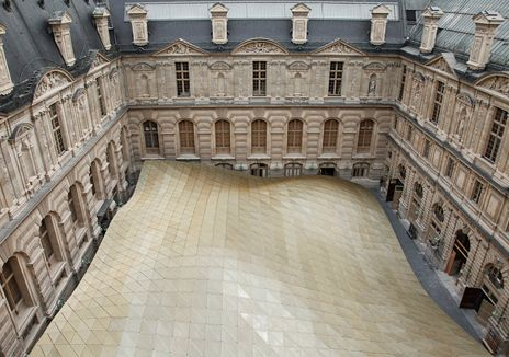 the Cour Visconti at the Musée du Louvre in Paris, gracefully contrasting with the eighteenth-century architecture. Designed by Mario Bellini and Rudy Ricciotti, the new structure houses the Department of Islamic Art, a two-story gallery that is partially submerged within the courtyard. The faceted roof has a soft translucency, allowing natural light into the gallery while maintaining the allure of a veil.