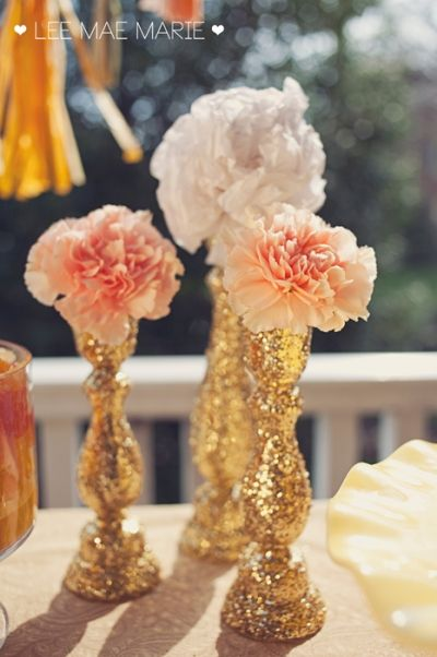DIY candlestick centerpieces. Spray paint candlesticks you already own or bought from a thrift store with gold glitter and add pink and white roses