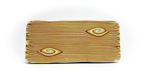 Polymeer klei hout suikerriet, rauw en ongebakken polymeer klei Kato suikerriet, klaar voor het snijden en genezen.  Aanbieding is voor één rauwe, ongebakken polymeer klei suikerriet, handgemaakt door mij met kwaliteit polymeerklei (Kato). Je moet het na van het merk specificaties bakken  Suikerriet lengte - 4 cm Suikerriet breedte - 5 cm Suikerriet hoge - 2, 2cm  Wandelstokken zijn zorgvuldig verpakt en verzonden in stevige dozen.  Hebt u vragen of verzoeken, stuur een email naar me.