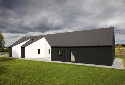 concave barn-like house exterior geometrically architecture