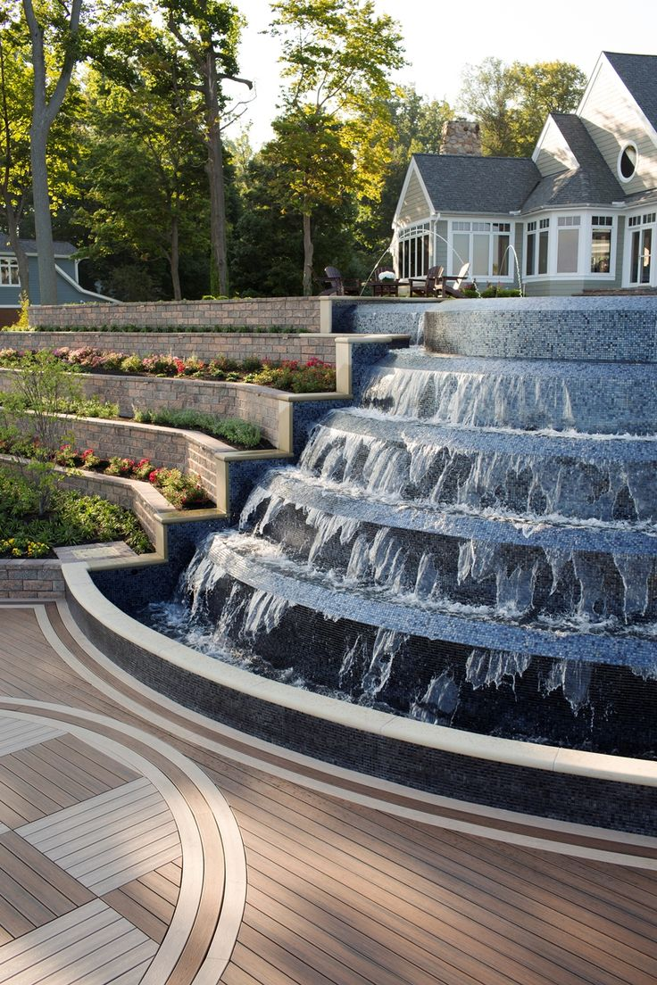 Backyard fountain featuring Trex Transcend in Spiced Rum. #outdoorliving, #fountain, #backyard, #lakesidehome