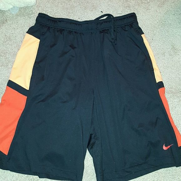 Nike basketball shorts Orange and red Nike basketball shorts worn only once or twice, very comfortable Nike Shorts