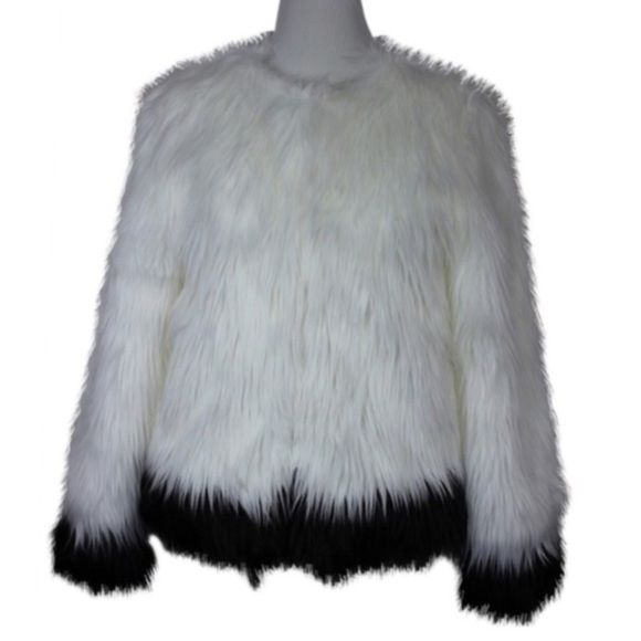 Michael Kors white faux fur jacket Get ready to hit the streets of New York in this luxurious jacket. Black fur accents the white body of the jacket and the sleeves. With the right price this jacket could be yours !! Beautiful piece. Still with the tags. Please remember that posh takes 20% size medium, hidden hooks to close, MEASUREMENTS: UA to UA-  20 inches Length- 26 inches Sleeve length- 25 inches. Machine wash cold, line dry, Acrylic, polyester mix for fabric content. (DDB) Michael Kors…