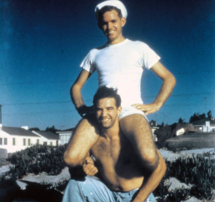 Man in sailor's cap on friend's shoulders :: ONE National Gay and Lesbian Archives
