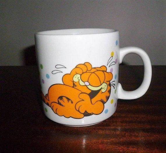 $12    Vintage 1978 Laughing Garfield Coffee Mug by the United Feature Syndicate Inc / Retro Orange Cat Tea Mug / Made in Korea by V1NTA6EJO