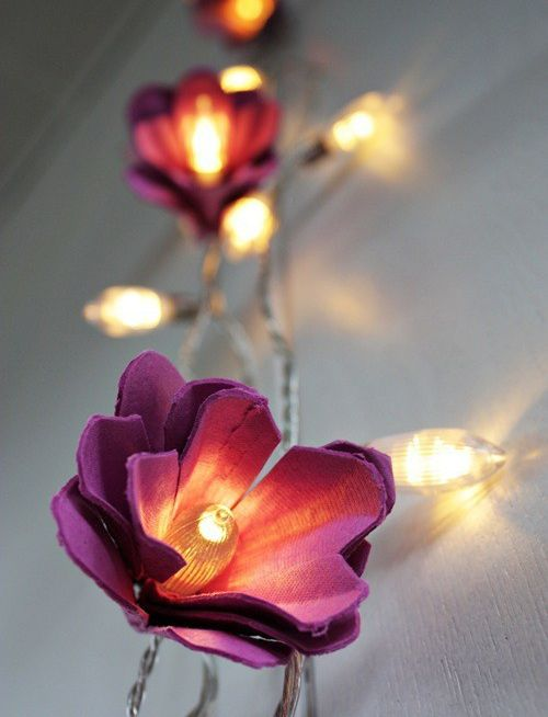 Egg cartons can transform old Christmas lights into flower garlands
