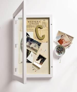 Here's how to fill a shadow box with treasured keepsakes. - use pins as a holder